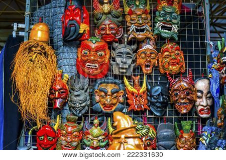 Chinese Replica Wooden Masks  Decorations Panjuan Flea Market  Beijing China.  Panjuan Flea Curio market has many fakes, replicas and copies of older Chinese products, many ancient.