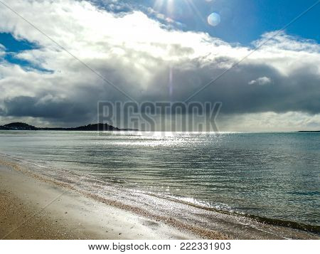 Beach on a cloudy day, Mission Bay, Auckland, New Zealand