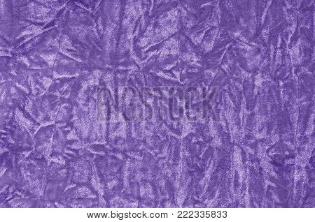 Closeup ultra violet color velvet fabric sample texture backdrop. Upholstery for decoration interior design or abstract background. poster