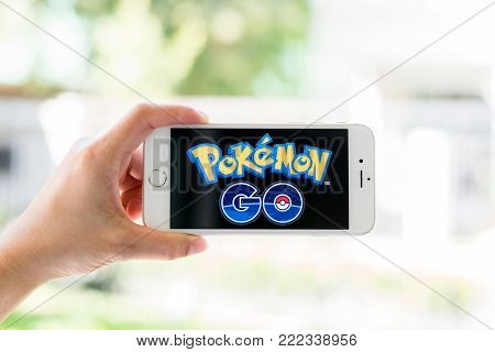BANGKOK, THAILAND - January 22, 2018: Iphone smart phone gadget on hand with screen showing application Pokemon Go mobile gps game app developed by Niantic for iOS and Android devices