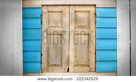 Old Vintage Wooden Closed Window on Cyan Plank Wall