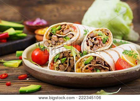 Burritos Wraps With Beef And Vegetables On A Wooden Background. Beef Burrito , Mexican Food. Healthy