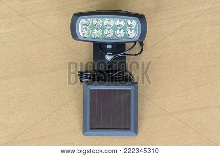 Generating electricity with solar lamp outdoor isolated on white.The lamp operates on electricity from batteries, charged through the use of solar photovoltaic panel.