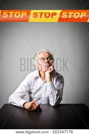 Old man in white and STOP line over his head. Restricted area concept.