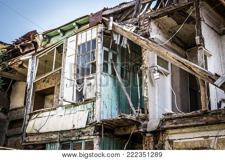 A dilapidated apartment building in the old districts of the city.