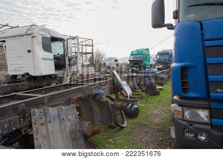 The old truck graveyard. Interior of abandoned old car. ruined, abandoned trucks
