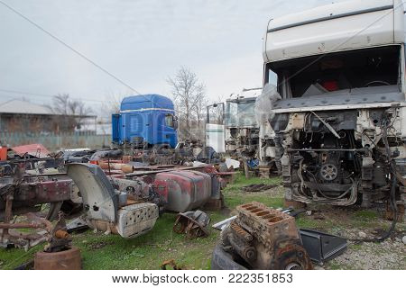 Old ruined, abandoned trucks. The old truck graveyard. Closeup of a old and abandoned truck