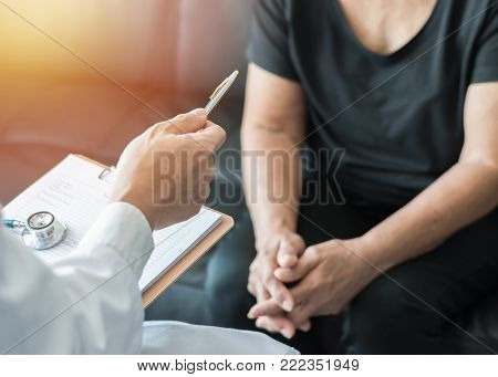 Geriatric doctor (geriatrician) consulting and diagnostic examining elderly senior adult patient (older person) on aging and mental health care in medical clinic office or hospital examination room poster