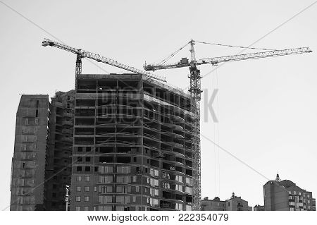 construction of new building with lift crane. real estate. residential house, skyscraper and architecture. startup service and business. future and family life, sweet home