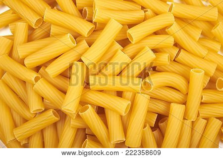 Background of Rigatoni italian pasta on the white