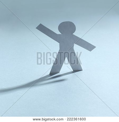 concept of leadership.one paper doll on the paper background