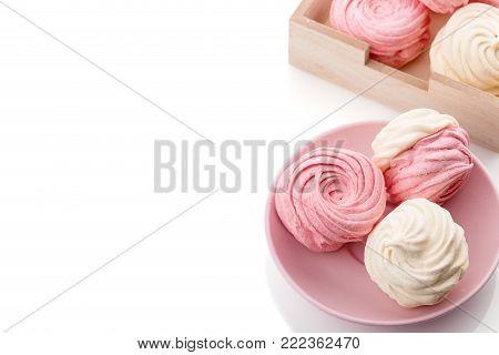 Homemade zephyr or marshmallow in pink plate isolated on white background with copy space. Marshmallow, Meringue, Zephyr. Valentine's or Mothers Day concept