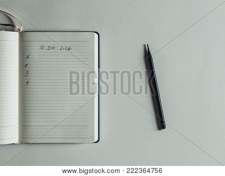 Opened Personal Organizer With A To Do List In Morning On White Background, Top View