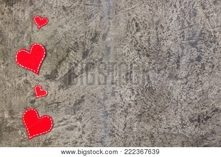 Red paper hearts isolated on gray concrete background. Valentine's Day. Copy space. Top view