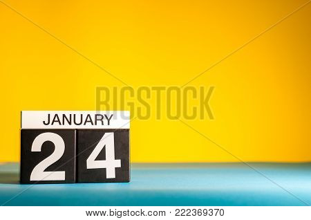 January 24th. Day 24 of january month, calendar on yellow background. Winter time. Empty space for text.