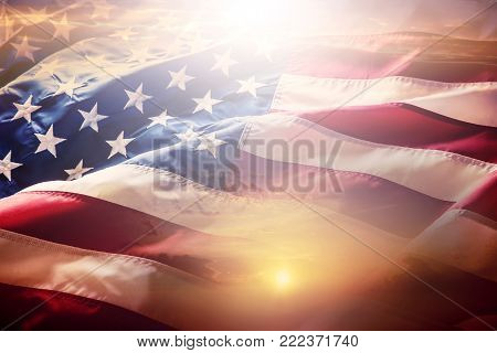 USA flag. American flag. American flag blowing wind at sunset or sunrise. Close-up.