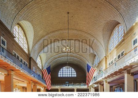 New York, USA, november 2016: The Great Registry Hall of the Ellis Island Immigration Museum with tourists