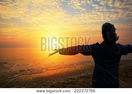 A woman looking to sunset on the beach (Had-Sai-Med-Rak) at Phetchaburi province, Thailand.