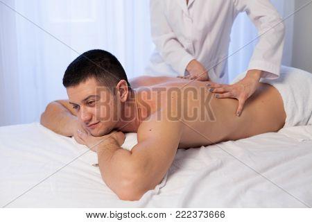 male masseur doing massage in the Spa