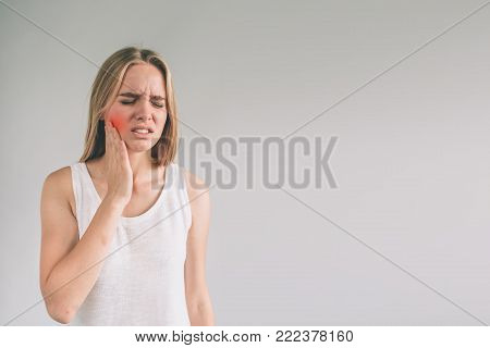 Teeth Problem. Woman Feeling Tooth Pain. Closeup Of Beautiful Sad Girl Suffering From Strong Tooth Pain. Attractive Female Feeling Painful Toothache. Dental Health And Care Concept