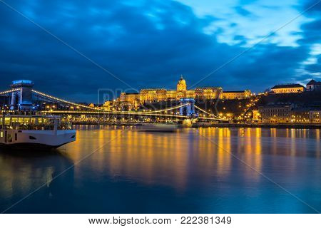 Illuminated building of Buda Castle and Chain bridge at night in  Budapest.  Hungary.