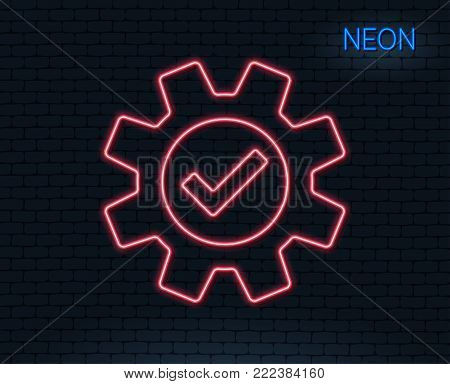 Neon light. Cogwheel line icon. Approved Service sign. Transmission Rotation Mechanism symbol. Glowing graphic design. Brick wall. Vector