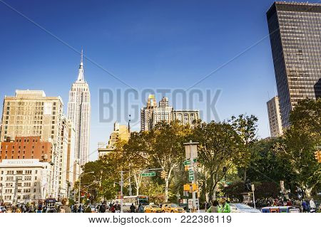 New York, USA, november 2016: urban view of Madison Square Park with the Empire State Building in the background