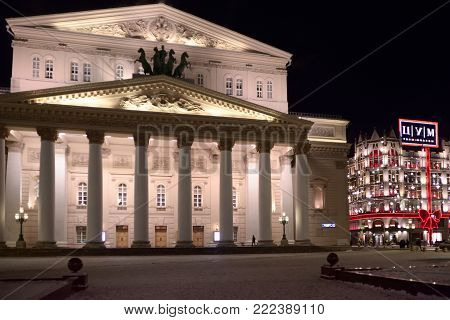 Theatre square, Moscow, Russia - January 08, 2018: Night view of Bolshoi Theater and Decoration for New year and Christmas TSUM store in Moscow, Russia.
