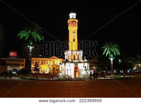 Izmir, Turkey - April 24, 2012: The Clock Tower in the central square of Konak in Izmir in the night, Turkey. Saat Kulesi (Izmir Clock Tower) is a symbol of the city and its most famous landmark.