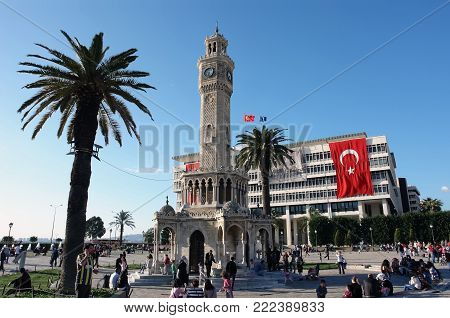 Izmir, Turkey - April 22, 2012: The days life in the central square of Konak in Izmir with its most famous landmark the Clock Tower, Turkey.