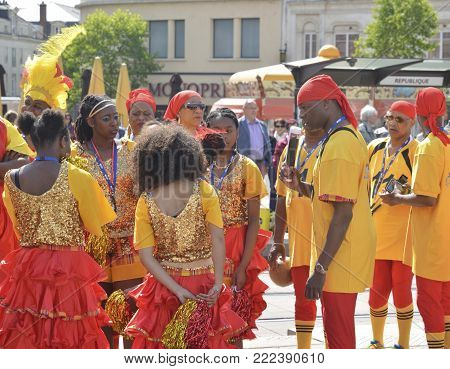 LE MANS, FRANCE - APRIL 22, 2017: Festival Evropa jazz Caribbean Musicians and dancers in the costumes in the city
