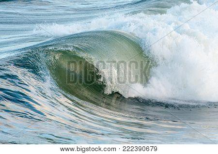 Waves on the Atlantic Ocean cresting near the beach.