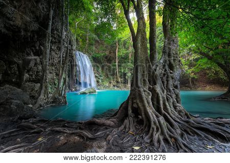 Jungle Landscape With Flowing Turquoise Water Of Erawan Cascade Waterfall At Deep Tropical Rain Fore
