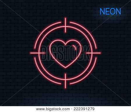 Neon light. Heart in Target aim line icon. Love dating symbol. Valentines day sign. Glowing graphic design. Brick wall. Vector