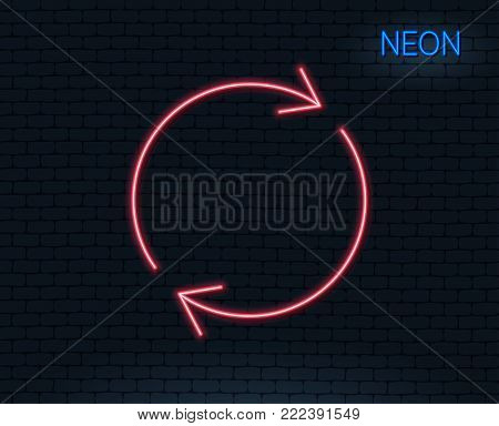 Neon light. Refresh line icon. Rotation arrow sign. Reset or Reload symbol. Glowing graphic design. Brick wall. Vector