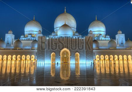 ABU DHABI, UNITED ARAB EMIRATES - DEC 31, 2017: Exterior of the Sheikh Zayed Mosque in Abu Dhabi in twilight. It is the largest mosque in the country. HDR photo.