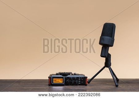 equipment for field audio recording on beige background. Usb microphone and recorder