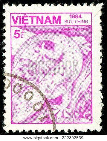 Ukraine - circa 2018: A postage stamp printed in Vietnam show reptile Tokay Gecko or Gekko gecko. Series: Fauna and Flora. Circa 1984.