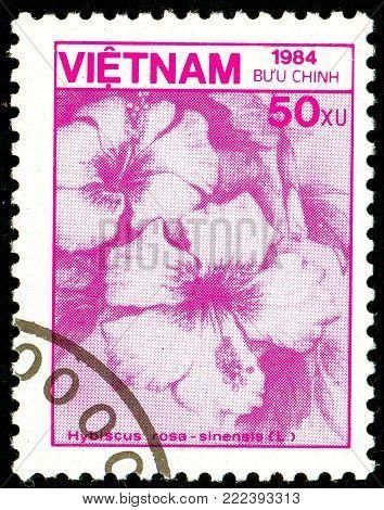 Ukraine - circa 2018: A postage stamp printed in Vietnam show flower Hibiscus rosa-sinensis. Series: Fauna and Flora. Circa 1984.