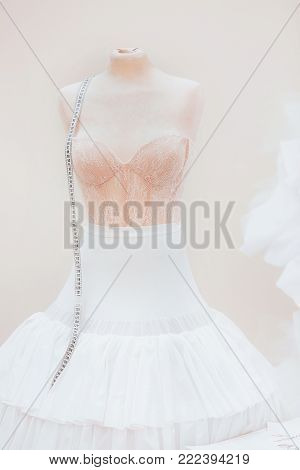 wedding corset on a mannequin. corset with sewing centimeter
