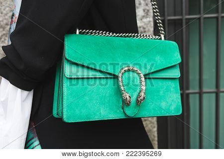 MILAN, ITALY - JANUARY 15: Detail of bag outside Armani fashion show during Milan Men's Fashion Week on JANUARY 15, 2018 in Milan.