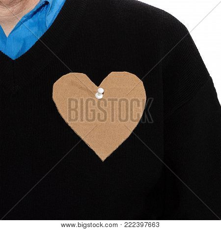 Roughly carved cardboard heart pinned to the clothes of a man