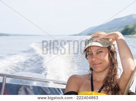 Young Girl Is Riding On Motorboat On The River In Summer Afternoon.