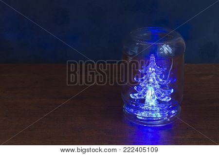 Holiday spruce in a jar.Gifts, preparation for the feast. Can all people afford it?