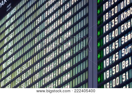 Close up image of flight departures board in brown tone