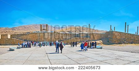 PERSEPOLIS, IRAN - OCTOBER 13, 2017: People visit world famous archaeological site, located on the plateau in Zagros mountains, on October 13 in Persepolis.