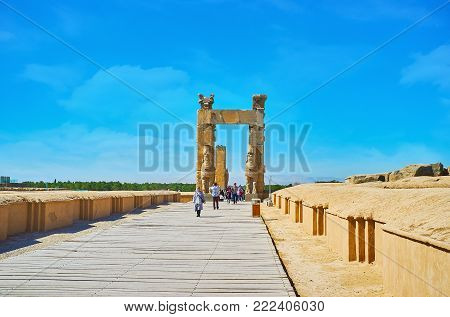 PERSEPOLIS, IRAN - OCTOBER 13, 2017: The way along the foundations of ancient buildings to All Nations Gates (Xerxes Gate), on October 13 in Persepolis.