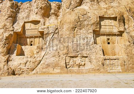 The giant tombs of Naqsh-e Rustam archaeological site are neighboring with equestrian reliefs, carved in rocky cliff, Iran.