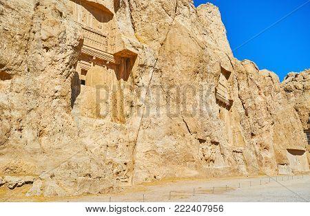 The massive rock with carved mausoleums in Naqsh-e Rustam Necropolis, Iran.