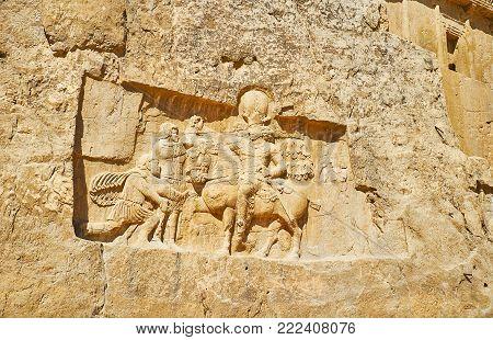 The ancient relief, depicting Triumph of Shapur I in Naqsh-e Rustam Necropolis, Iran.